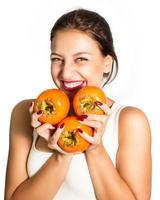 vrouw die dol was op persimmon! foto