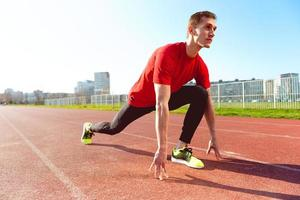 atleet opwarmen en strekken foto