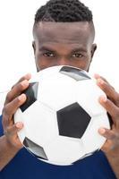 close-up portret van een serieuze voetballer foto