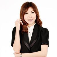 Aziatische vrouw. glimlachende Aziatische onderwijs / bedrijfsvrouw. foto
