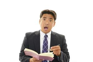 verrast Aziatische zakenman foto