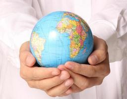 globe, aarde in de hand