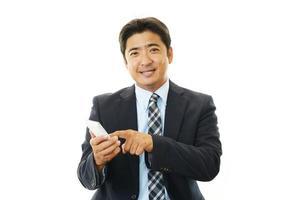 lachende Aziatische zakenman foto