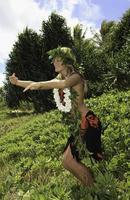 Hawaiiaanse hula danste door een tienermeisje foto