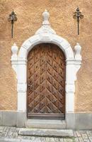 Zweedse deuropening in Gamla Stan, Stockholm. foto