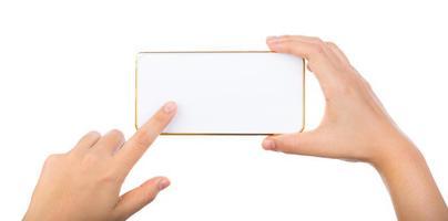 vrouwelijke hand met gouden mobiele telefoon-smartphone