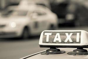 afbeelding ondertekenen een taxi van beige kleur foto