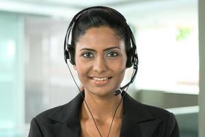 mooie Indiase callcentermedewerker. foto