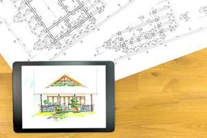 digitale tablet met bouwplannen foto