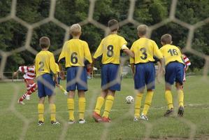 blokkeren in voetbalspel foto