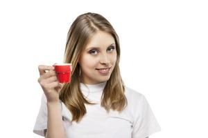 meisje drinkt een kopje koffie foto