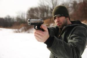 schieten pistool foto