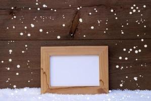 Kerstkaart met fotolijst, kopie ruimte, sneeuwvlokken, sneeuw