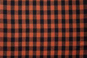 rode anb zwart geruit tafelkleed textuur, achtergrond met kopie ruimte foto