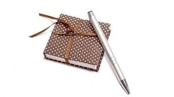 notebook met pen foto