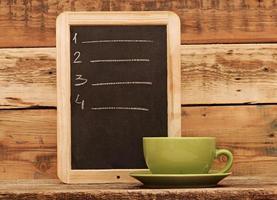 restaurant schoolbord menu, geschreven in wit krijt foto