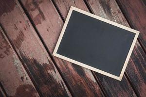 schoolbord op oude houten foto