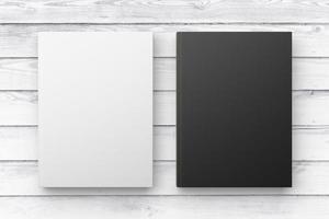 witte en zwarte dagboeken op witte houten vloer. bespotten foto