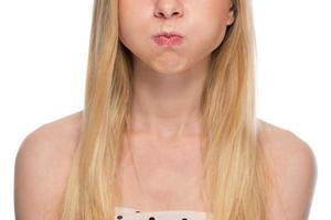 close-up op tiener die adem houdt foto