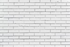 een witte bakstenen muur met patroon en textuur
