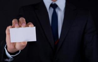 blanco visitekaartje in een hand - voorraadbeeld foto