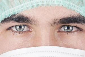 mannen arts in een masker foto
