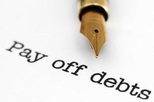 betalen van schulden foto