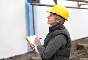 inspecteur op de bouwplaats foto
