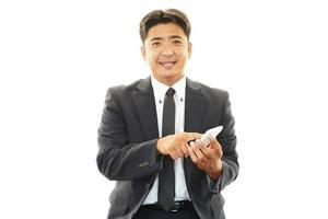 mobiele telefoon en zakenman. foto