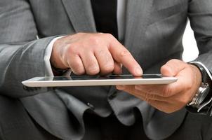 zaken doen met digitale tablet foto