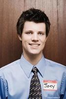 zakenman dragen naamplaatje foto