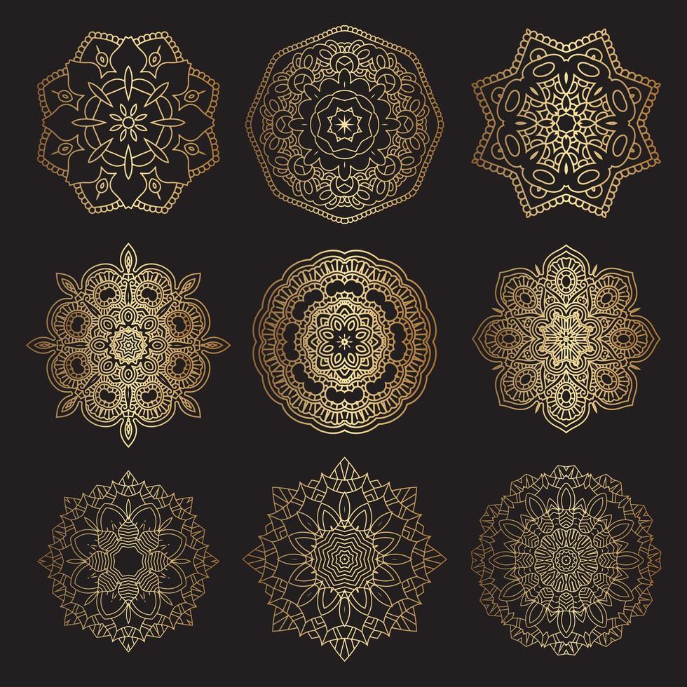 decoratieve mandala-ontwerpen in goud en zwart vector