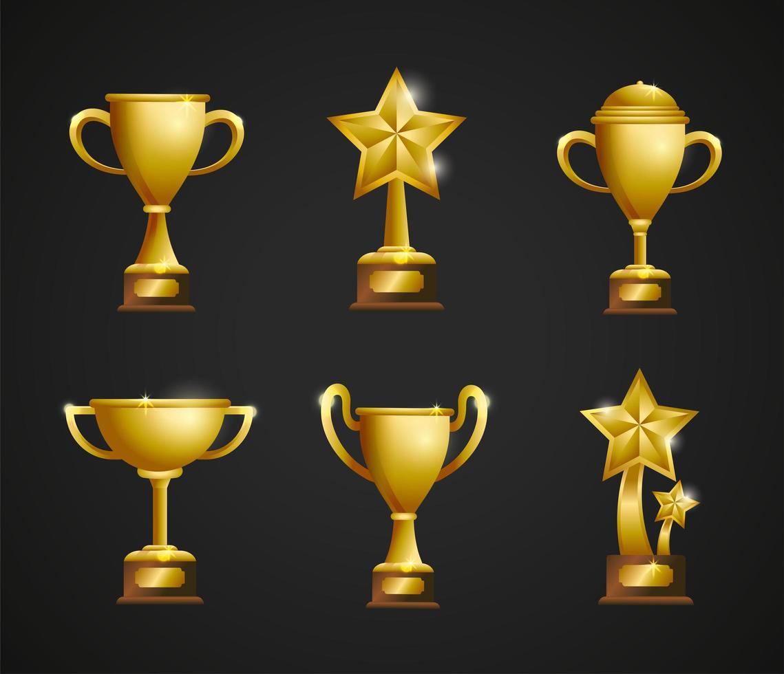 set gouden awards trofeeën en bekers vector