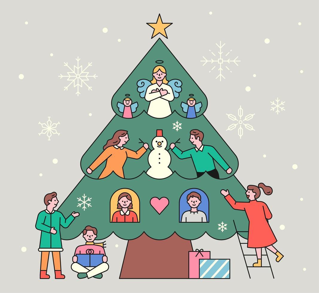 mensen versieren een enorme kerstboom. vector