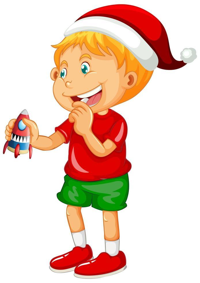 schattige jongen kerstmuts dragen en spelen met zijn speelgoed op witte achtergrond vector