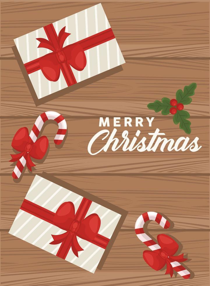 vrolijk kerstfeest belettering met geschenken en wandelstokken op houten achtergrond vector