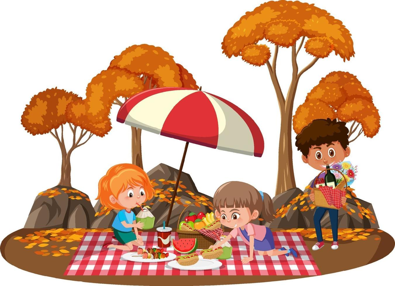 kinderen picknicken in het park met veel herfstbomen vector