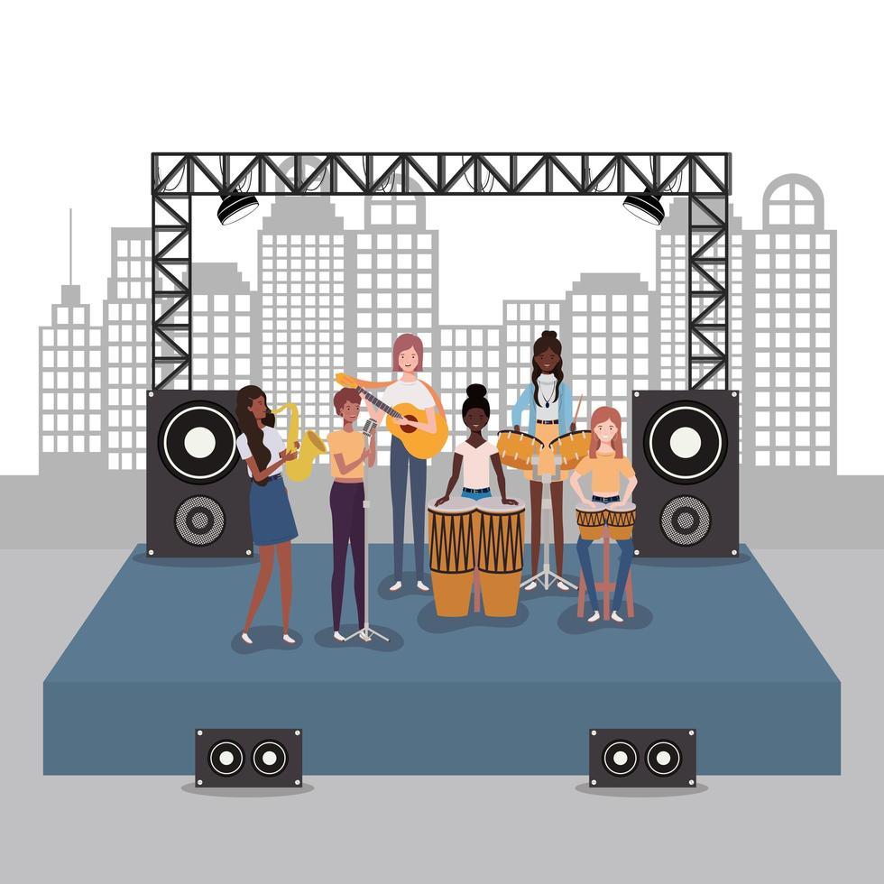groep interraciale vrouwen die muziek in een band spelen vector