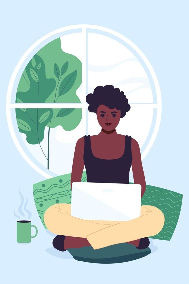een jonge afrikaanse amerikaanse vrouw werkt thuis met behulp van een laptop. lente of zomer buiten het raam. platte vectorillustratie vector