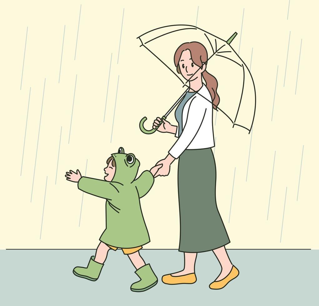 een moeder en een kind in kikkerregenjassen lopen vrolijk door de regen. hand getrokken stijl vector ontwerp illustraties.