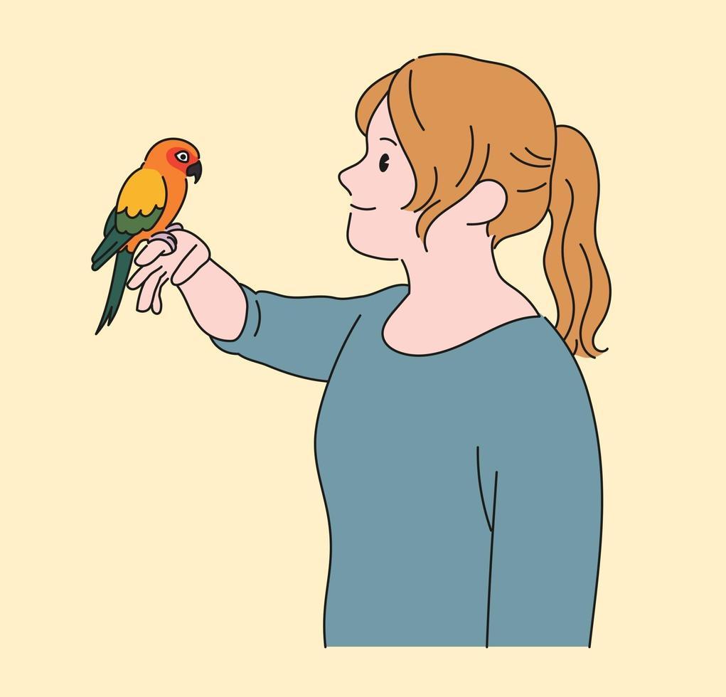 een meisje kijkt toe met een papegaai in haar hand. hand getrokken stijl vector ontwerp illustraties.