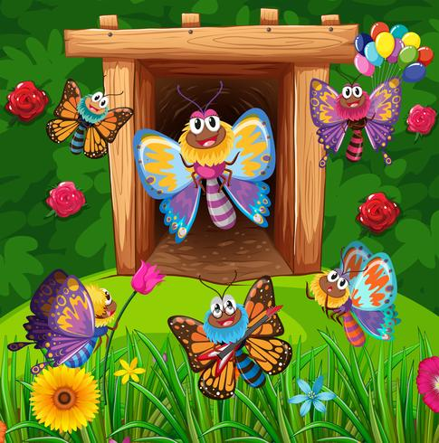 Kleurrijke vlinders die in tuin vliegen vector