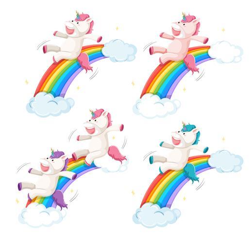 Set van happy eenhoorn dia op regenboog vector