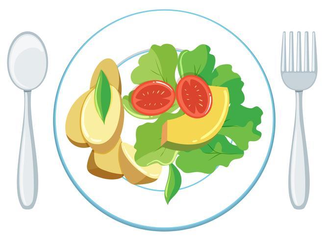 Salade en aardappeltjes op plaat vector