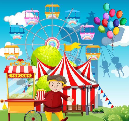 Mens die popcorn verkoopt bij funpark vector