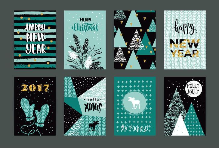 Reeks artistieke creatieve Vrolijke Kerstmis en Nieuwjaarskaarten. vector