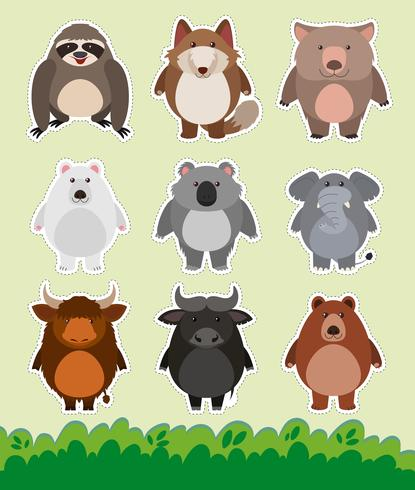 Stickerontwerp met schattige dieren op gras vector