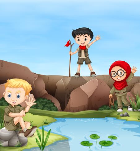 Kinderen kamperen aan de rivier vector