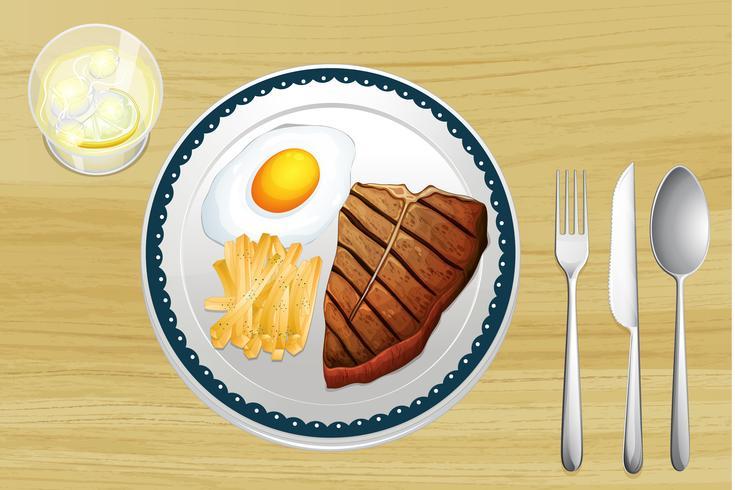 Biefstuk, eieren en friet vector