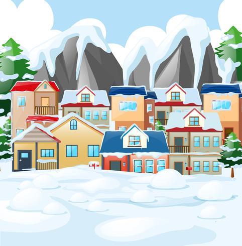 Buurtscène met huizen die door sneeuw worden behandeld vector